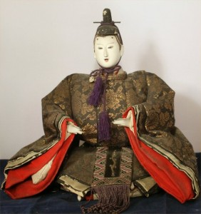 A Meiji-era style dairi. He is a bit worn at the edges (and hairline) but his brocade robe is still fresh.