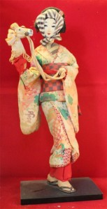 """This sakura doll represents a ritual dance (""""Spring Horse"""")."""