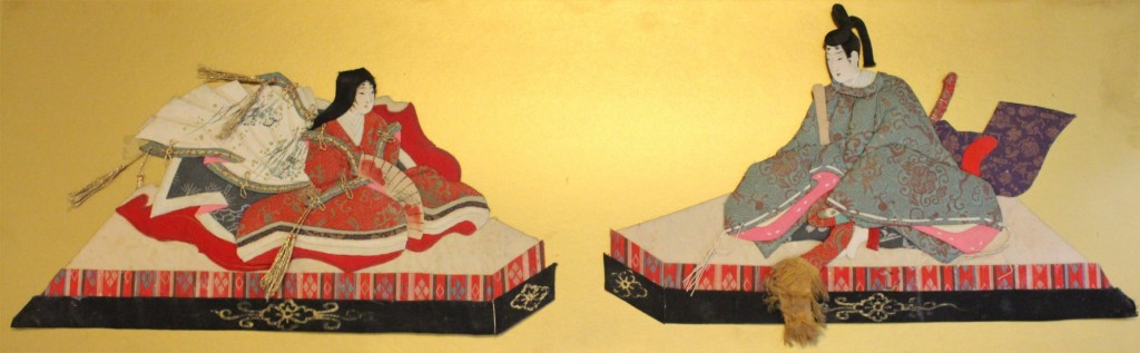 A 20th-century oshie (padded picture) hina pair. The dolls are designed to face each other, which softens the usual hieratic positioning and suggests mutual affection.