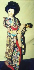 The lady doll here is a young girl handling a lion puppet in a Kabuki play.