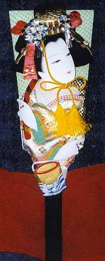 """A hagoita (made using oshi-e or """"padded painting"""") showing the salt-scooper."""