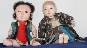 Two play dolls, meant to encourage nurturing, sewing skills, and imaginative play. Late 19th-early 20th century.