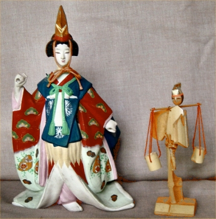 Two salt-scooper dolls. The pottery doll suggests a kabuki or dance performance of matsukaze; the woman's robe is decorated with pine-tree motifs. The bamboo doll would not seem to represent a story at all--just a common worker--were it not for the golden cap, which reminds us of the heroines.