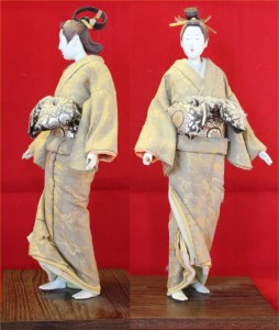 Two views of a doll representing an 18th-century oiran (these top-class prostitutes tied their obi bows in front)