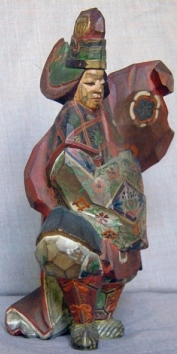 An itto-bori carving of a Bugaku (ancient court) dancer. This is about 6 inches tall . The face is left unpainted.